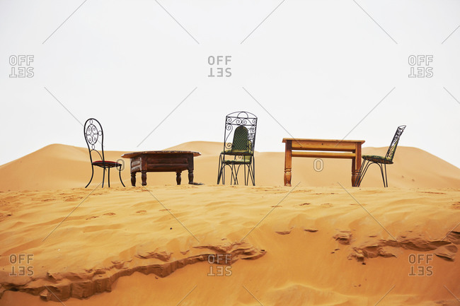 Tables and chairs on sand dunes in Morocco
