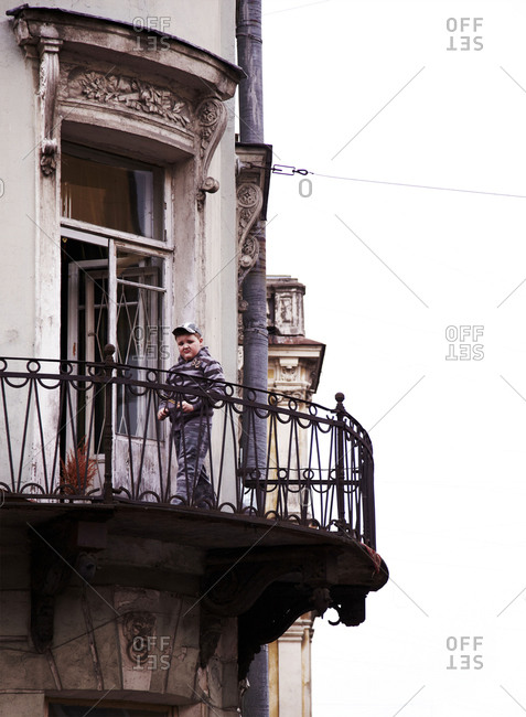 St. Petersburg, Russia - May 12, 2011: Young boy on terrace of building in St. Petersburg, Russia