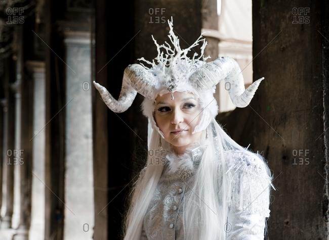 Venice, Italy - February 13, 215: Girl in carnival costume