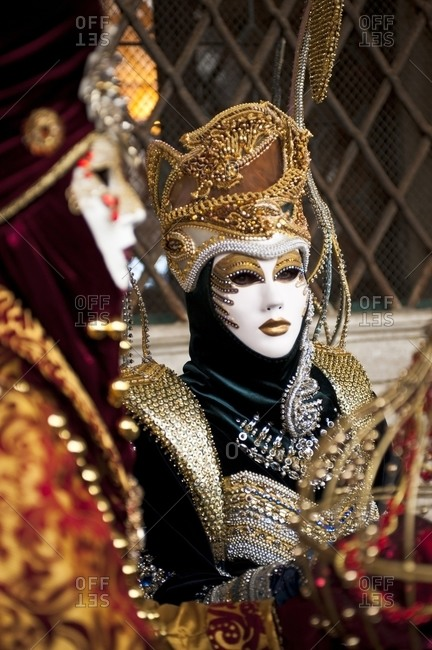 Carnival masks in glittering clothes, Venice, Italy