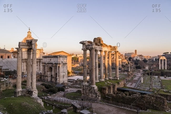 Sunset light on the Roman Forum and the Colosseum in Rome, Italy