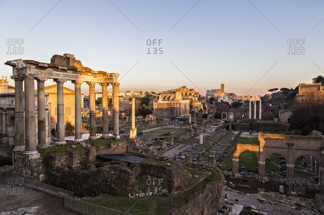 Sunset over the Roman Forum and the Colosseum in Rome, Italy