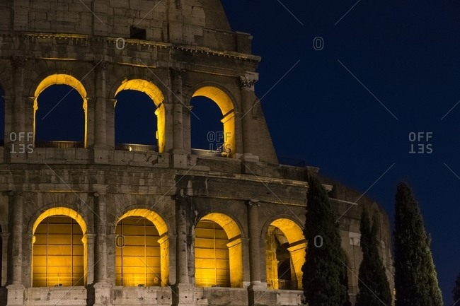 Colosseum illuminated at night, Rome, Italy