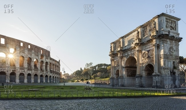 Colosseum at sunrise with the Arch of Constantine, Rome, Italy