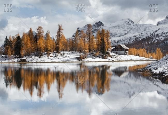 Autumn with snow on the Federa lake, Belluno, Italy