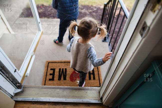 Children walking out the front door