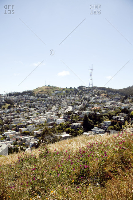 Sutro Tower seen over buildings and hilltops