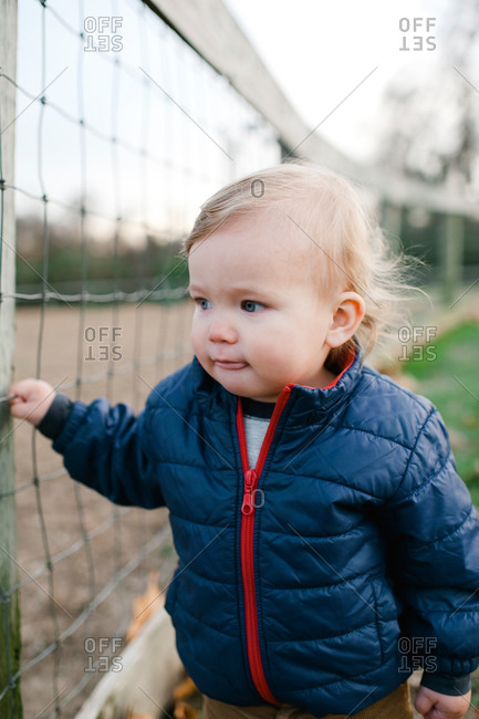 Portrait of toddler boy at a park
