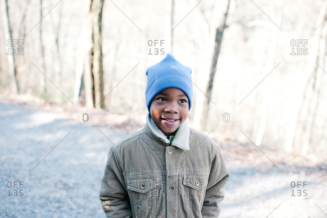 Boy standing outside in the winter