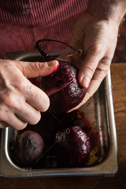 Chef peeling roasted beets