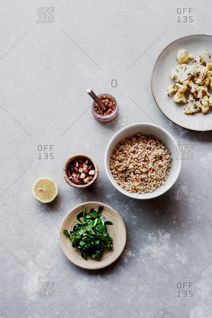 Ingredients for Israeli couscous salad with cauliflower, chard, and sundried tomato pesto