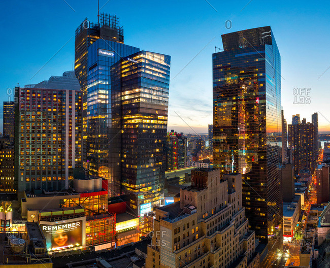 New York, NY, USA - April 12, 2015: High rise office buildings in New York at dusk