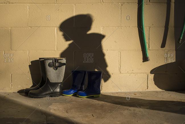 Shadow of boy on a garage wall