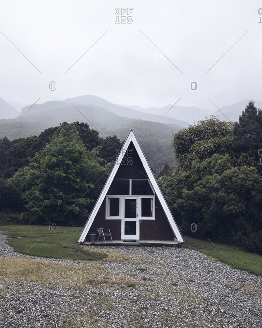 A-frame cottage in mountain landscape