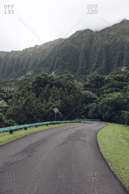 Scenic road below the mountains in Hawaii