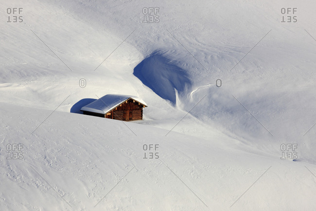 Lodge in deep snow in, Austria