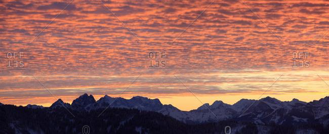 Mountain range under glowing sunrise, Germany