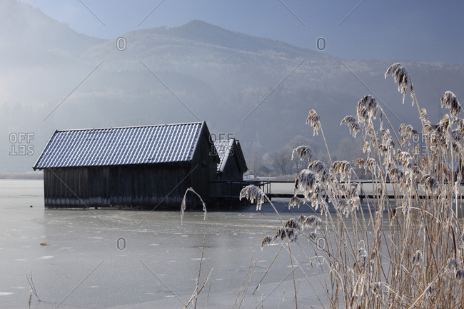 Boathouses on German lake in winter