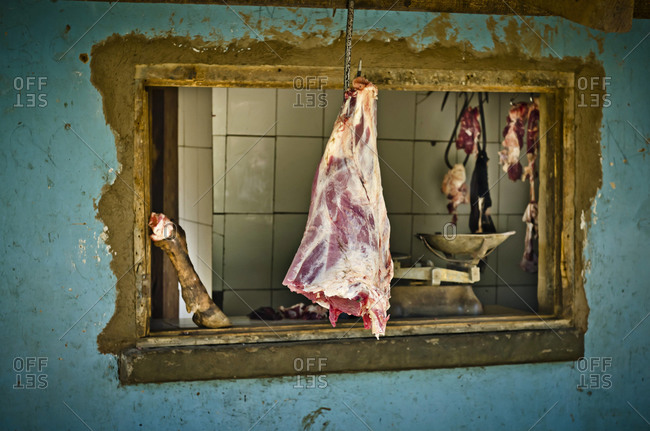 Meat hanging at Tanzanian butcher shop
