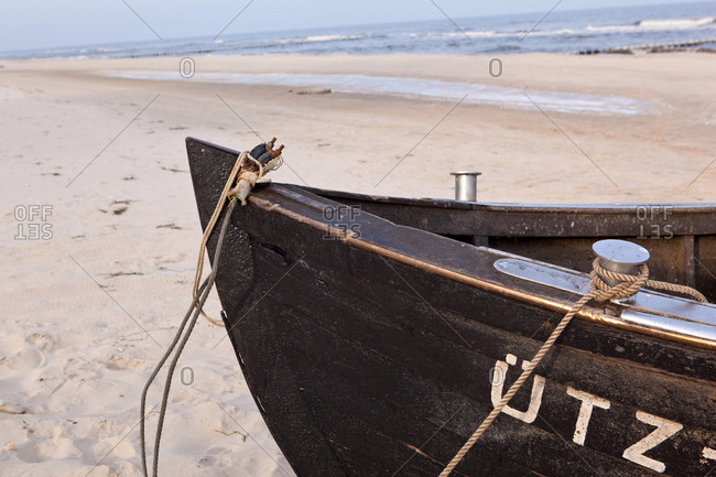 Close up of fishing boat on beach