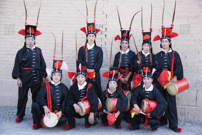 Gansu, China - October 20, 2008: Chinese drum group in traditional costumes