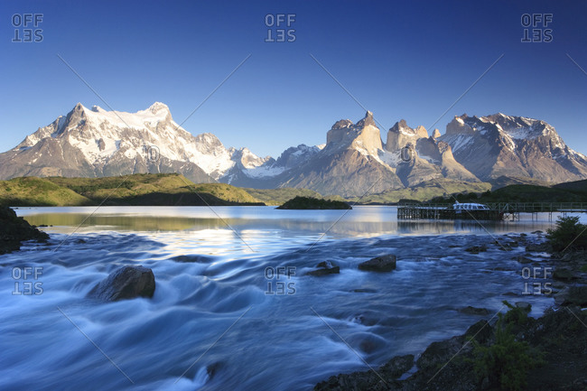 Lake Pehoe and river in Chilean mountains