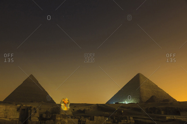 Pyramids and Sphinx during light show, Cairo, Egypt