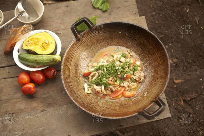 Food in a wok in Thailand