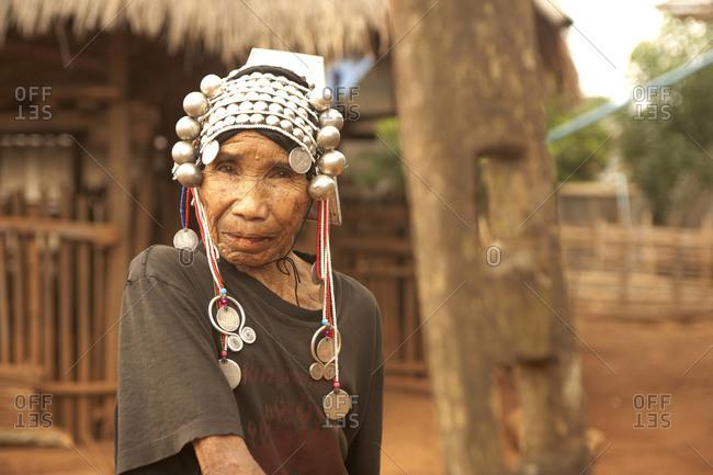 Mae Hong Son, Thailand - April, 2011: Elderly ethnic Thai woman with headdress