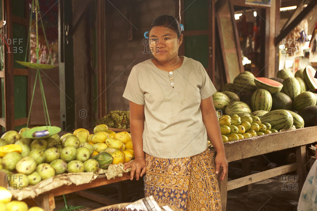 Burma - May 2011: Woman at her fruit stand in Burma