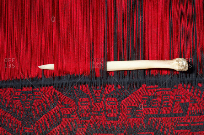 Loom with red fabric in Bolivia