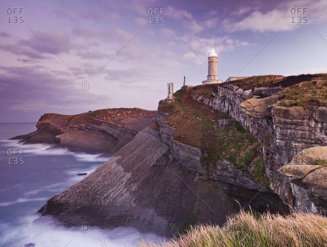 Lighthouse on remote coastal cliffs