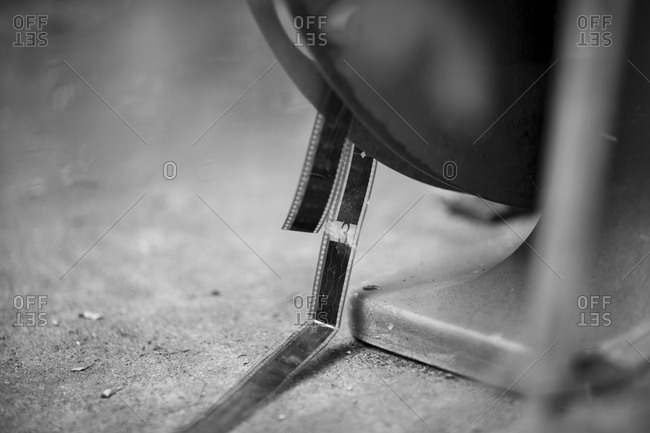 Old film reel on ground