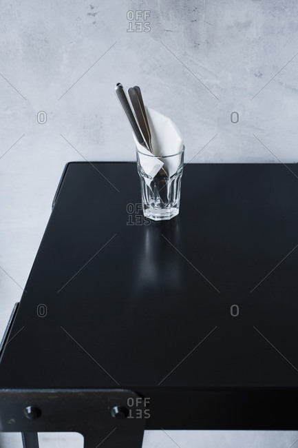Flatware in glass on cafe table