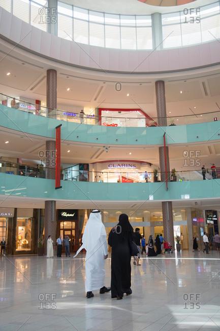 Dubai, UAE - September 16, 2012: Curved atrium in a multi-story shopping mall in Dubai