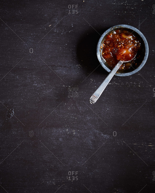 Jam in a ceramic bowl on a dark surface