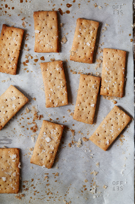 Caraway seed rye crackers on a baking sheet
