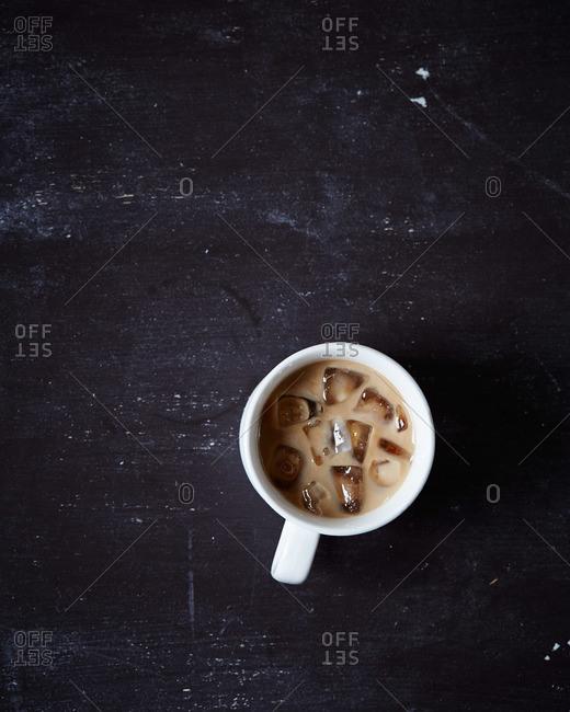 Iced coffee in a white mug