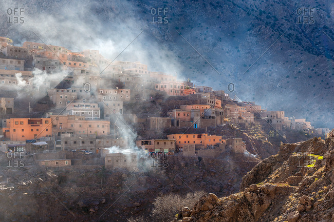 Steam rising from a berber village in the High Atlas Mountains, Morocco