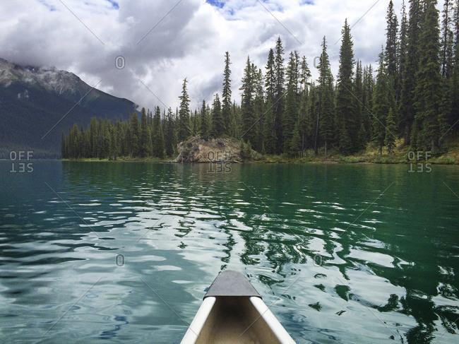 Canoe ride on a mountain lake in Alberta, Canada