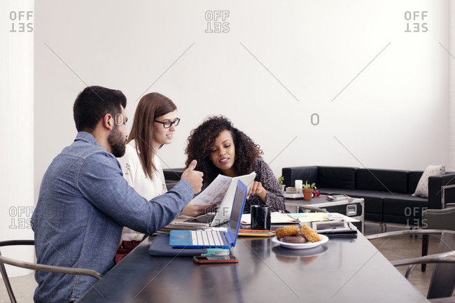 Young professionals collaborating in a meeting
