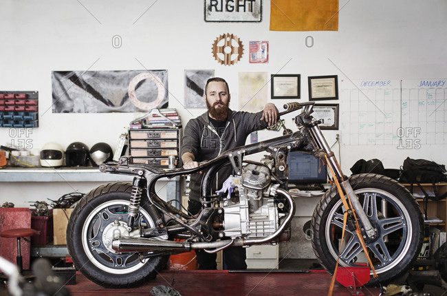 Mechanic with a partially built motorcycle