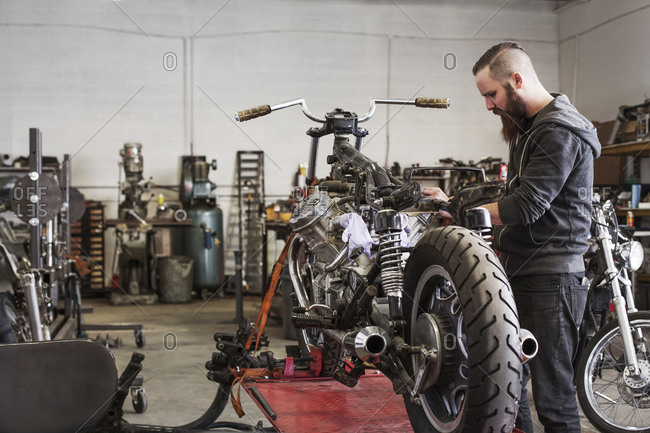 Mechanic working on a motorcycle