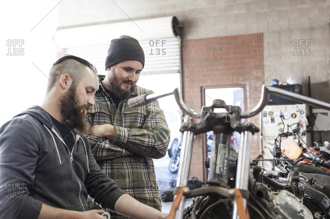 Mechanics working together on a motorcycle
