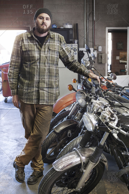 Portrait of a mechanic in a shop with motorcycles