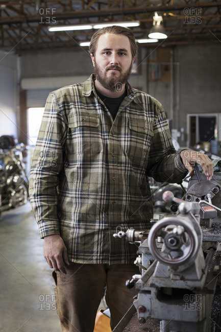 Portrait of a repairman in a motorcycle shop