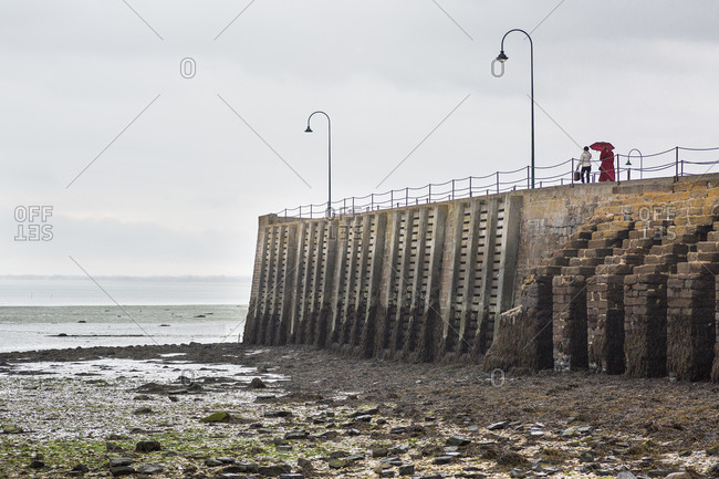 Tourists on pier in the rain, Cancale, France