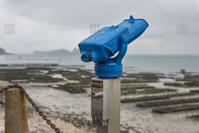 Tourist telescope looking over oyster beds, Cancale, France