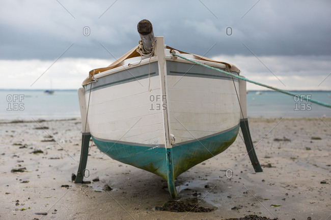Small sailboat aground on a cloudy day, Cancale, France