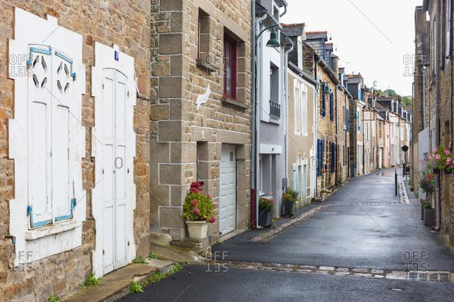 Street of quaint houses on rainy day, Cancale, France